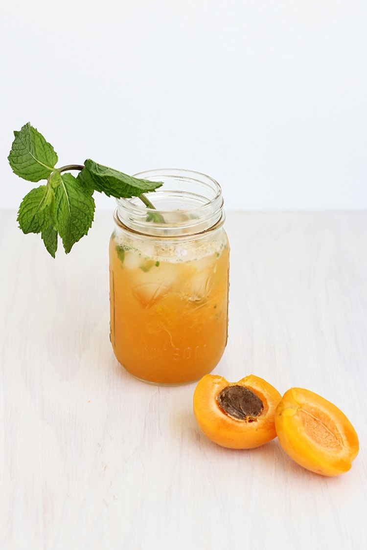 ... filled with ice and garnished with fresh orange slices and mint sprigs