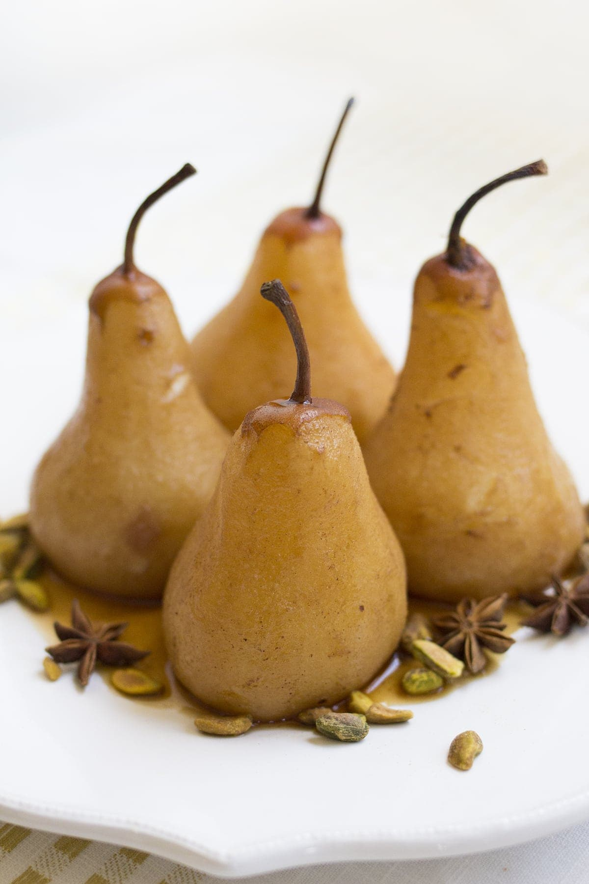Chai Poached Pears with Whipped Cream and Pistachios
