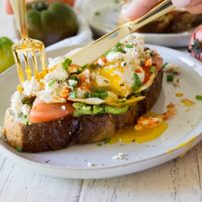 Fried Egg Avocado Toast with Tomato and Feta Cheese
