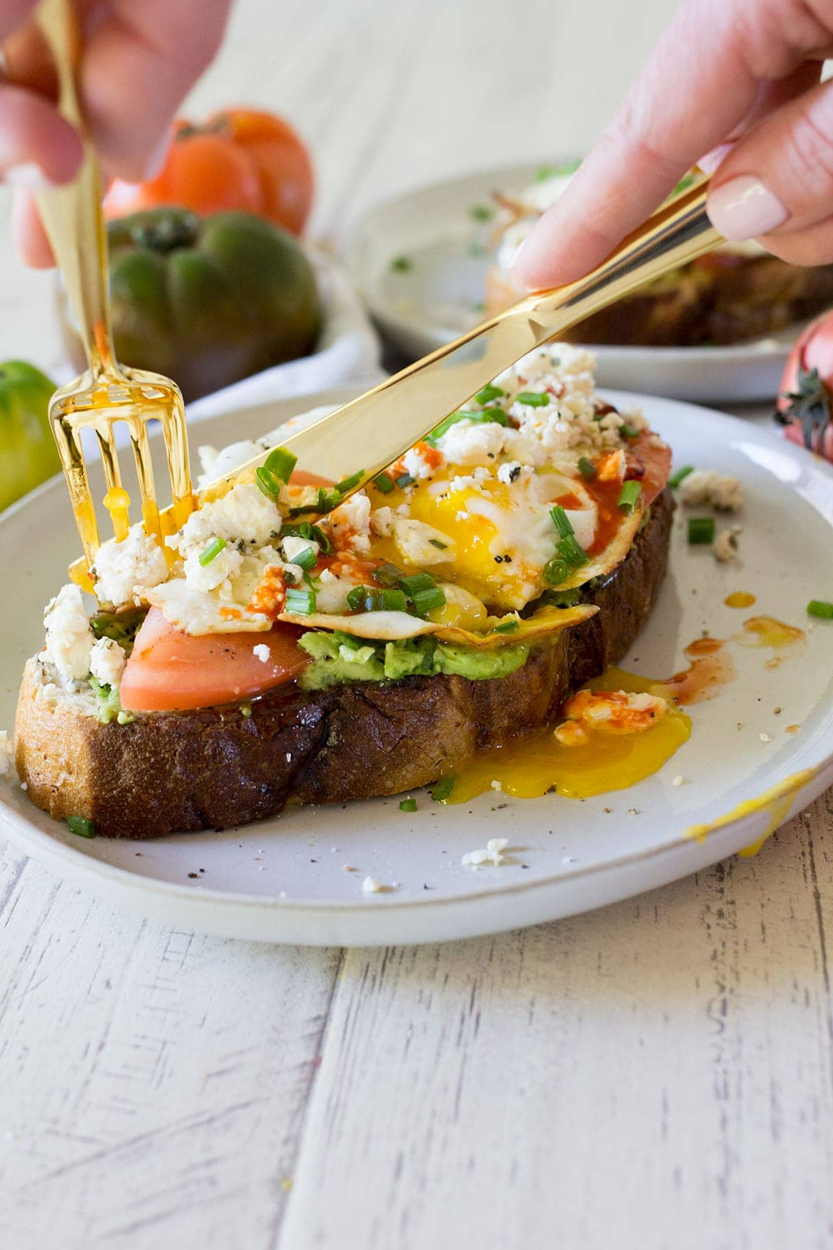 Fried Egg Avocado Toast With Tomato And Feta Cheese