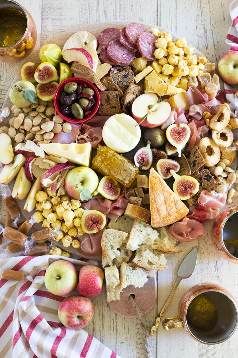 Fall Harvest Apple Inspired Cheese Board is a great party appetizer board to enjoy with friends and a bottle of crisp hard apple cider. I'm sharing all of my easy fall cheese board display ideas and Trader Joe's ingredient list. #cheeseboardIdeas #DIYcheeseboard #cheeseboarddisplay #cheeseboardrecipes #easycheeseboard #traderjoes #fall #holiday #howtomakea #wooden #fall #harvest #apple #cheeseboard #traderjoescheeseboard #fallcheeseboard