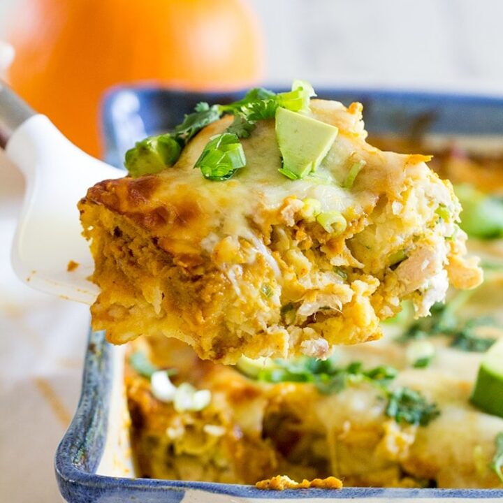 Pumpkin Chicken Enchiladas with a Pumpkin Enchilada Sauce make an easy and delicious family weeknight or weekend dinner perfect for fall. #enchiladas #pumpkin #chickenenchiladas #pumpkinenchiladas #enchiladasauce #glutenfree #glutenfreeenchiladas #pumpkinspice #dinner #weeknightdinner #easydinner #rotisseriechicken