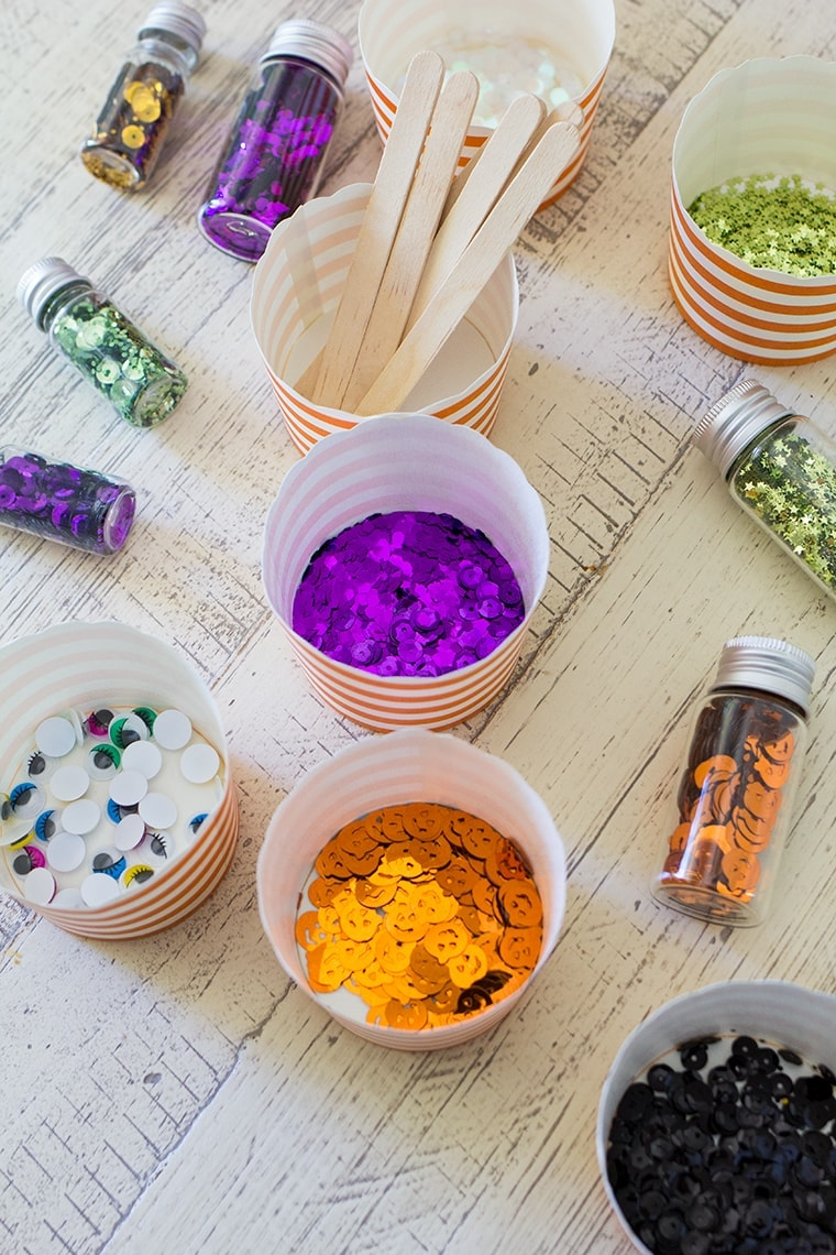 Toddler Safe Halloween Glitter Slime Recipe only has 3 Ingredients and no Borax so it's worry free for kids. Great for sensory play, preschool, or kindergarten classrooms. Mess free and quick to make for ages 3 and up. #Slime #BakingSoda #Glue #ContactLenses #Goo #Solutions #Glitter #Magic #Craft #Kids #KidsCraft #SlimeRecipe #Diy #Activities #KidsStuff