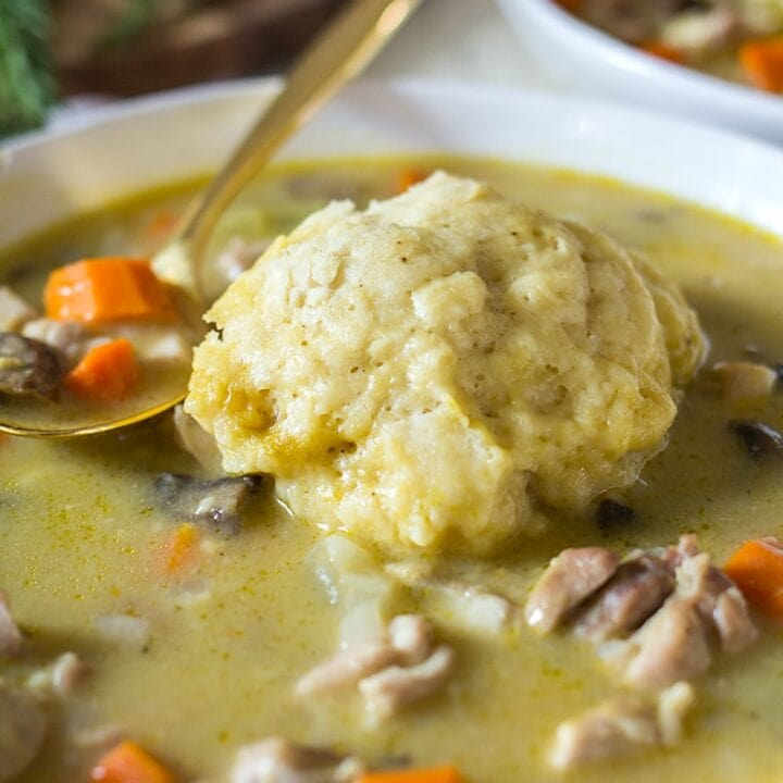 Easy Chicken and Dumplings from Scratch with mushrooms. A creamy chicken and mushroom soup finished with light and fluffy homemade dumplings. This soup recipe is the ultimate comfort food! #chicken #soup #dumplings #mushroomsoup #chickensoup