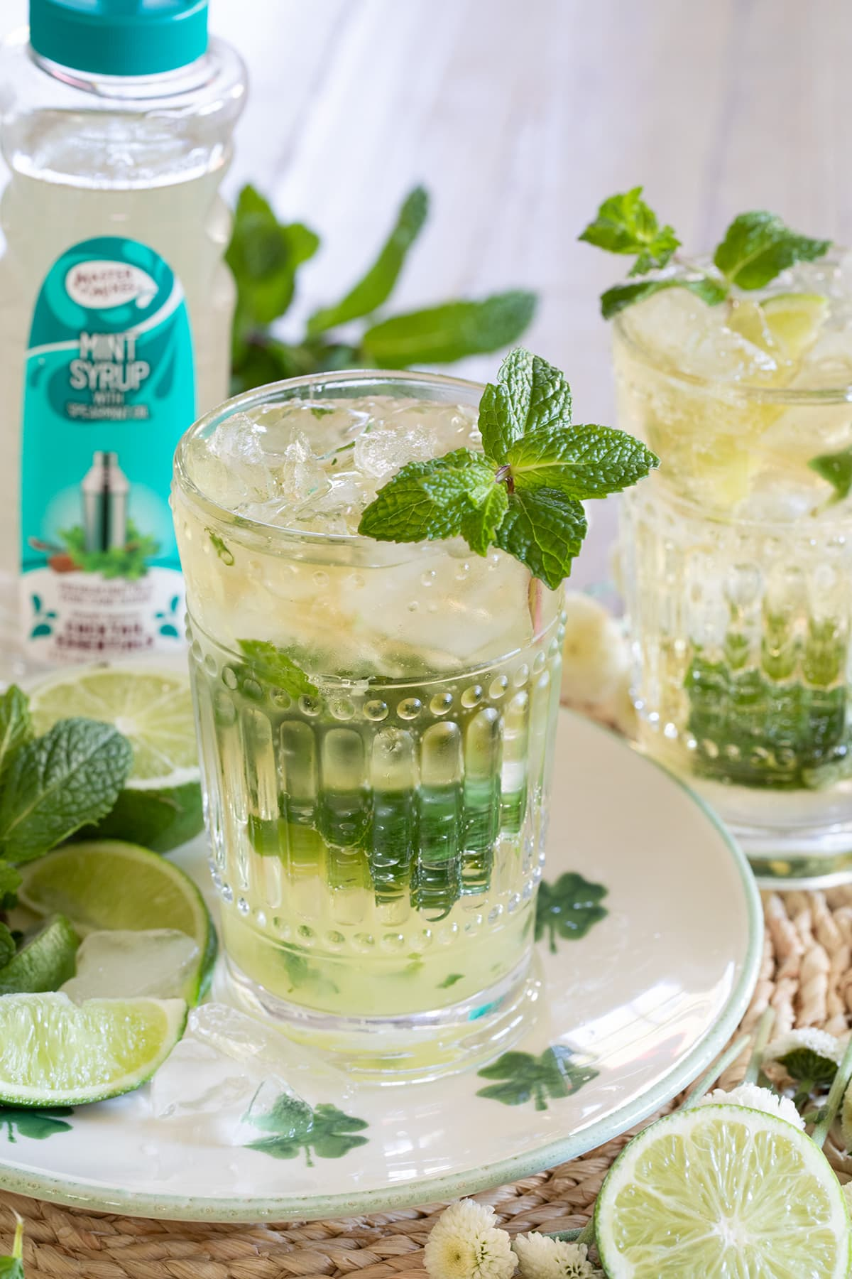 Irish Mint Mojitos are the perfect St. Patrick's Day cocktail made with Irish Whiskey, Mint Simple Syrup, muddled mint and limes and topped with club soda. #stpatricksday #mojito #whiskeycocktail #irishmojito