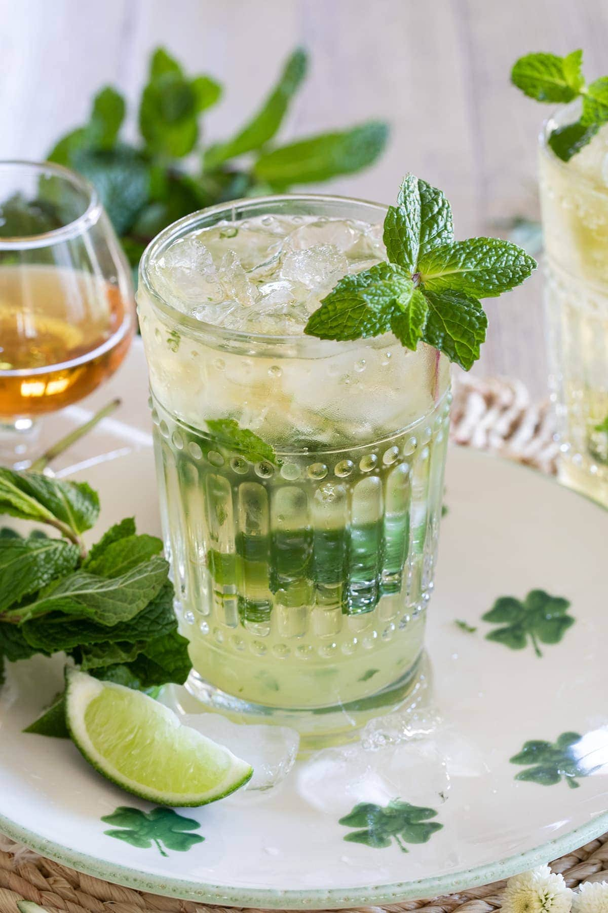 Irish Mint Mojitos are the perfect St. Patrick's Day cocktail made with Irish Whiskey, Mint Simple Syrup, muddled mint and limes and topped with club soda.